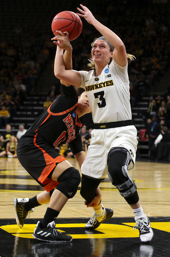 Iowa Hawkeyes guard Makenzie Meyer (3) tries to pull in a rebound during the first round of the 2019 NCAA Women's Basketball Tournament at Carver Hawkeye Arena in Iowa City on Friday, Mar. 22, 2019. (Stephen Mally for hawkeyesports.com)