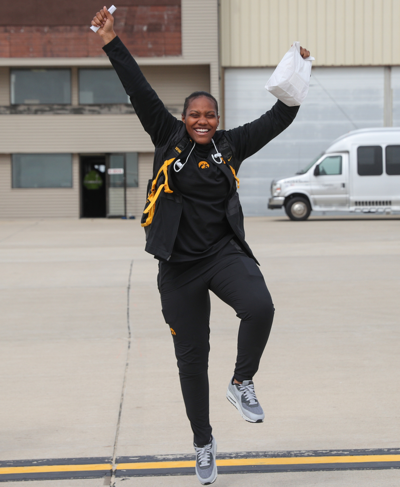 Iowa Hawkeyes guard Zion Sanders (24) boards the team plane to Greensboro, NC for the Regionals of the 2019 NCAA Women's Basketball Championships Thursday, March 28, 2019 at the Eastern Iowa Airport. (Brian Ray/hawkeyesports.com)