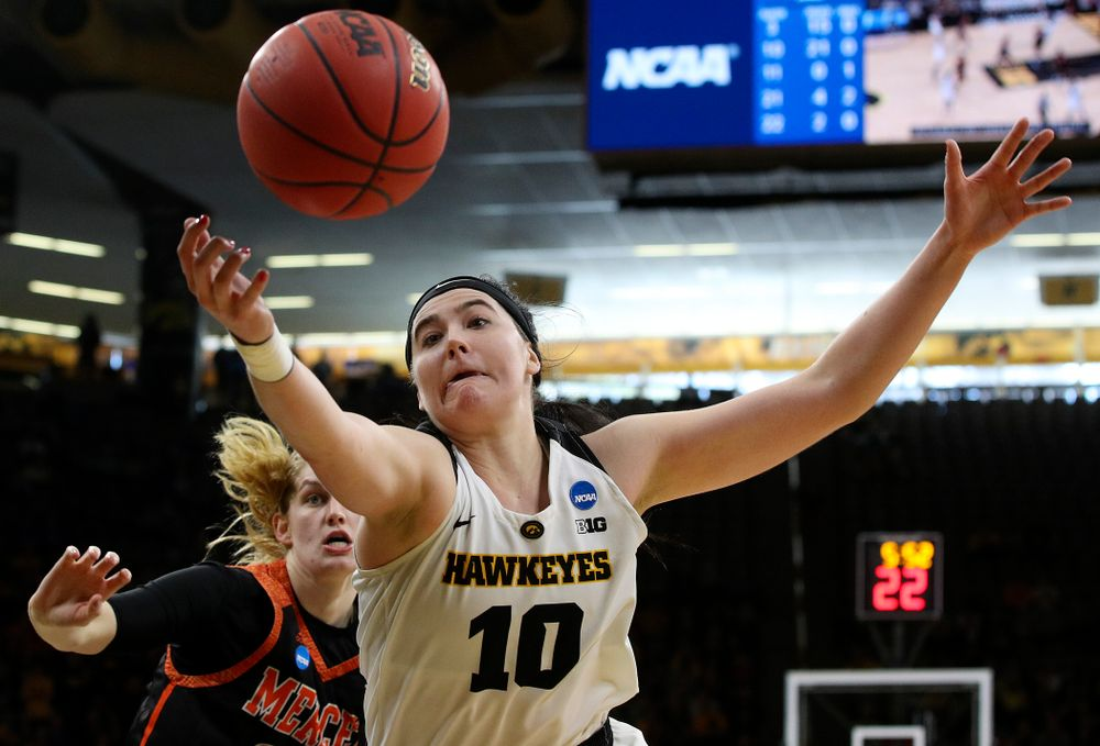 Iowa Hawkeyes forward Megan Gustafson (10) tries to pull in a loose ball during the first round of the 2019 NCAA Women's Basketball Tournament at Carver Hawkeye Arena in Iowa City on Friday, Mar. 22, 2019. (Stephen Mally for hawkeyesports.com)
