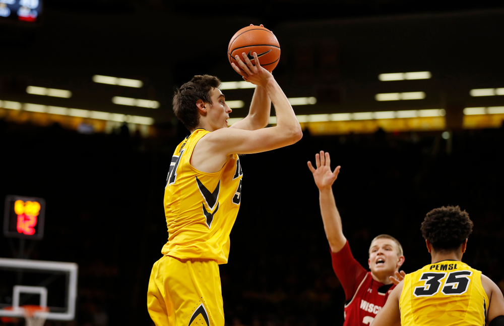Iowa Hawkeyes forward Nicholas Baer (51)