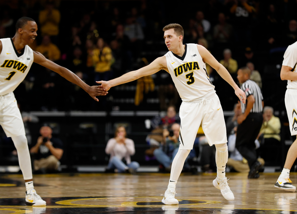 Iowa Hawkeyes guard Jordan Bohannon (3) and guard Maishe Dailey (1)