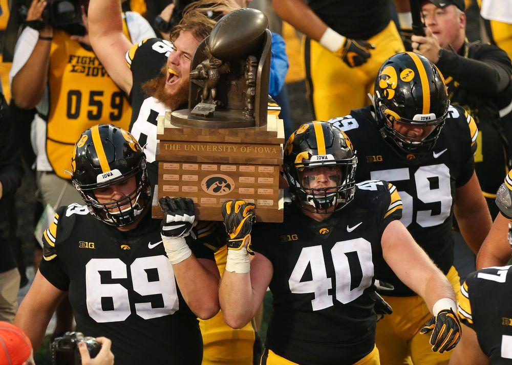 Iowa Hawkeyes offensive lineman Keegan Render (69), Iowa Hawkeyes defensive end Parker Hesse (40)