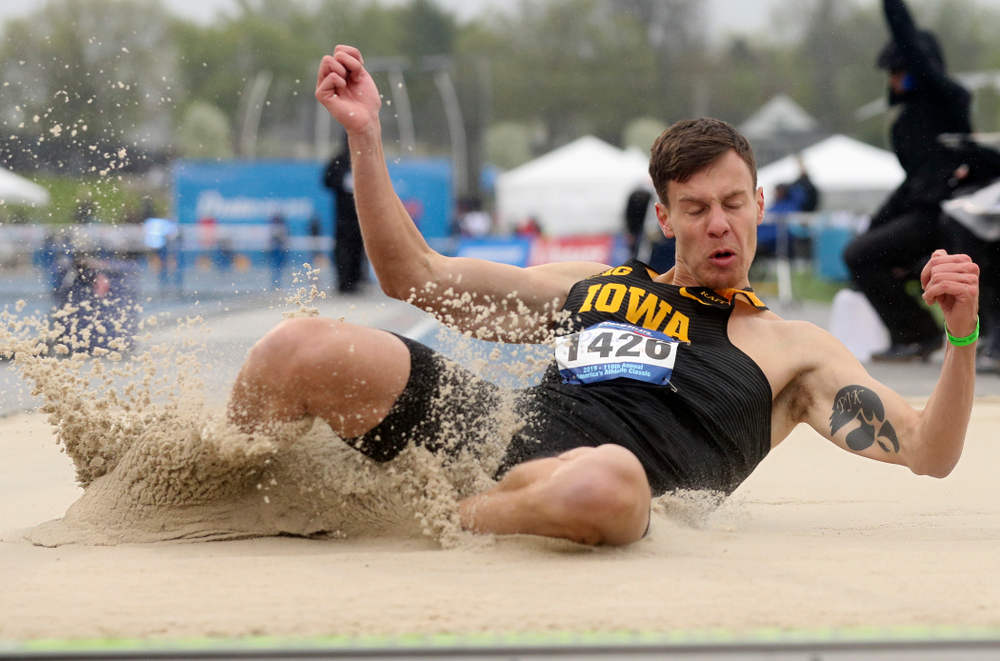 Iowa's Cooper Koenig jumps in the men's long jump event during the third day of the Drake Relays at Drake Stadium in Des Moines on Saturday, Apr. 27, 2019. (Stephen Mally/hawkeyesports.com)