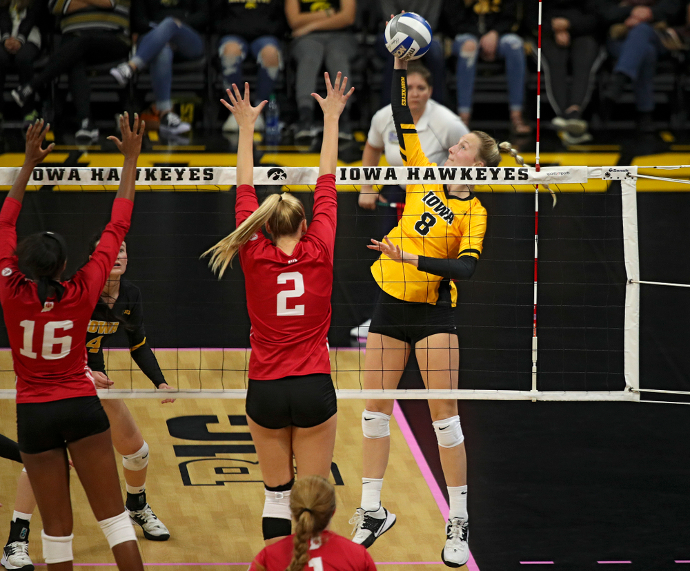 Iowa's Kyndra Hansen (8) gets a kill during their match at Carver-Hawkeye Arena in Iowa City on Sunday, Oct 20, 2019. (Stephen Mally/hawkeyesports.com)
