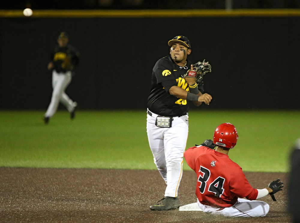 Iowa infielder Izaya Fullard (20) throws to first to complete a double play during the eighth inning of their game at Duane Banks Field in Iowa City on Tuesday, March 3, 2020. (Stephen Mally/hawkeyesports.com)