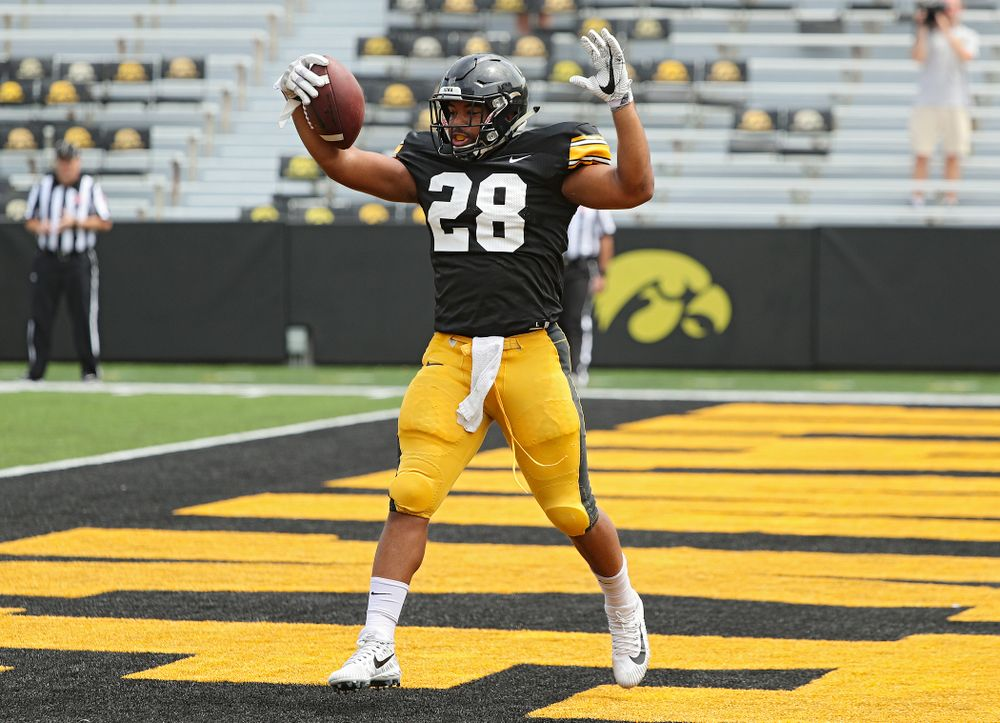 Iowa Hawkeyes running back Toren Young (28) scores a touchdown during Fall Camp Practice No. 8 at Kids Day at Kinnick Stadium in Iowa City on Saturday, Aug 10, 2019. (Stephen Mally/hawkeyesports.com)
