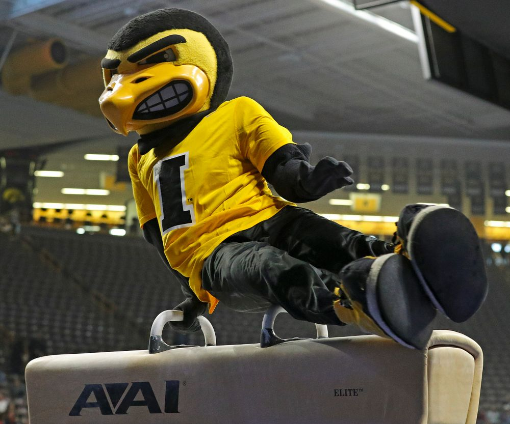 Herky swings on the pommel horse during the second day of the Big Ten Men's Gymnastics Championships at Carver-Hawkeye Arena in Iowa City on Saturday, Apr. 6, 2019. (Stephen Mally/hawkeyesports.com)