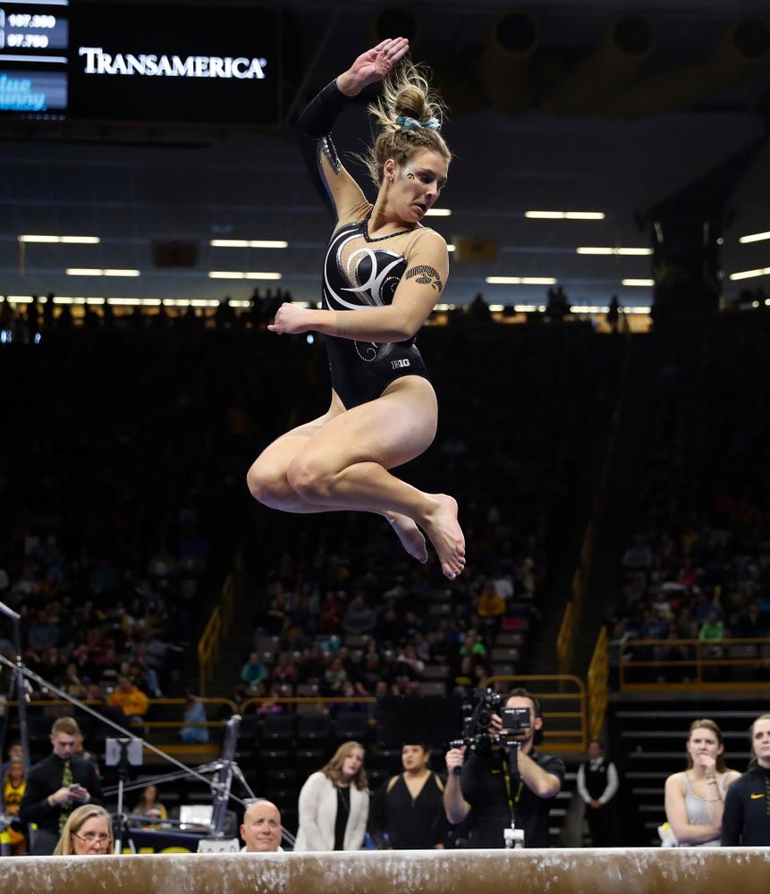 Iowa's Sydney Hogan competes on the beam against the Nebraska Cornhuskers