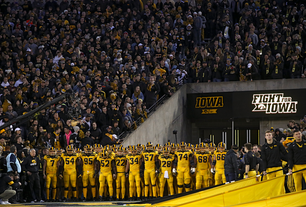 The Hawkeyes prepare to swarm the field before their game at Kinnick Stadium in Iowa City on Saturday, Oct 12, 2019. (Stephen Mally/hawkeyesports.com)