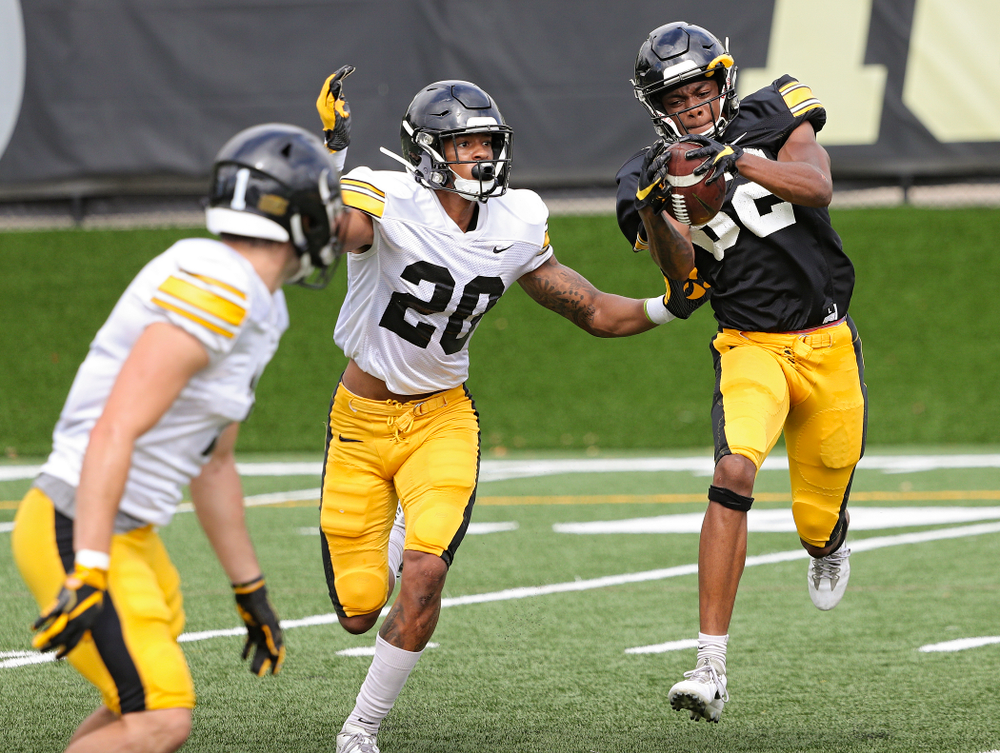 Iowa Hawkeyes wide receiver Calvin Lockett (82) pulls in a pass as defensive back Julius Brents (20) defends during Fall Camp Practice No. 10 at the Hansen Football Performance Center in Iowa City on Tuesday, Aug 13, 2019. (Stephen Mally/hawkeyesports.com)