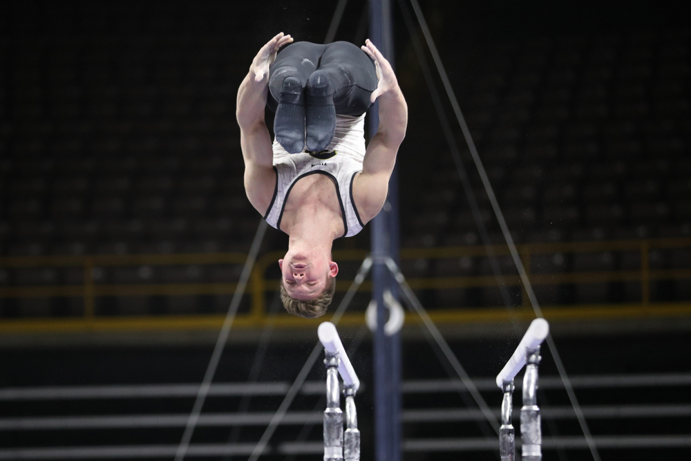 Iowa's Stewart Brown competes on the parallel bars against UIC and Minnesota Saturday, February 2, 2019 at Carver-Hawkeye Arena. (Brian Ray/hawkeyesports.com)