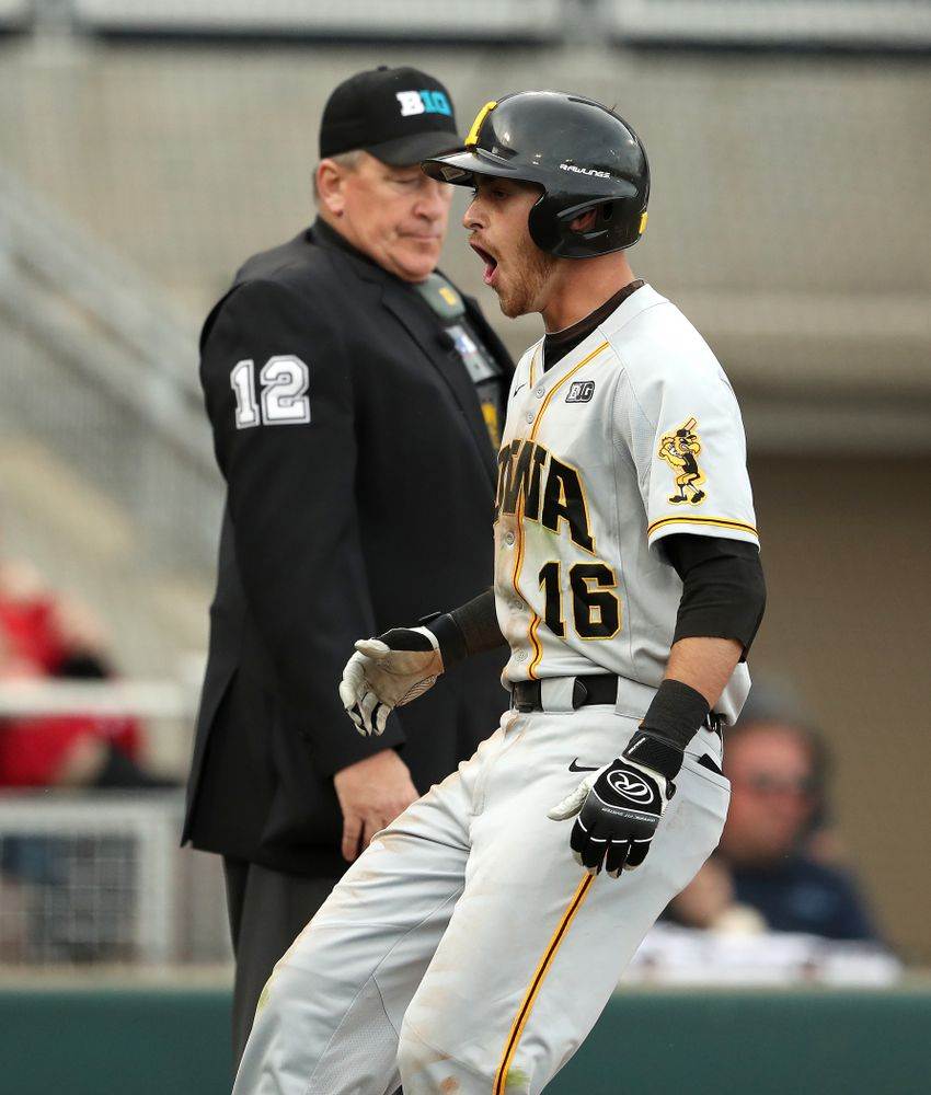 Iowa Hawkeyes Tanner Wetrich (16) reacts after scoring against the Indiana Hoosiers in the first round of the Big Ten Baseball Tournament Wednesday, May 22, 2019 at TD Ameritrade Park in Omaha, Neb. (Brian Ray/hawkeyesports.com)