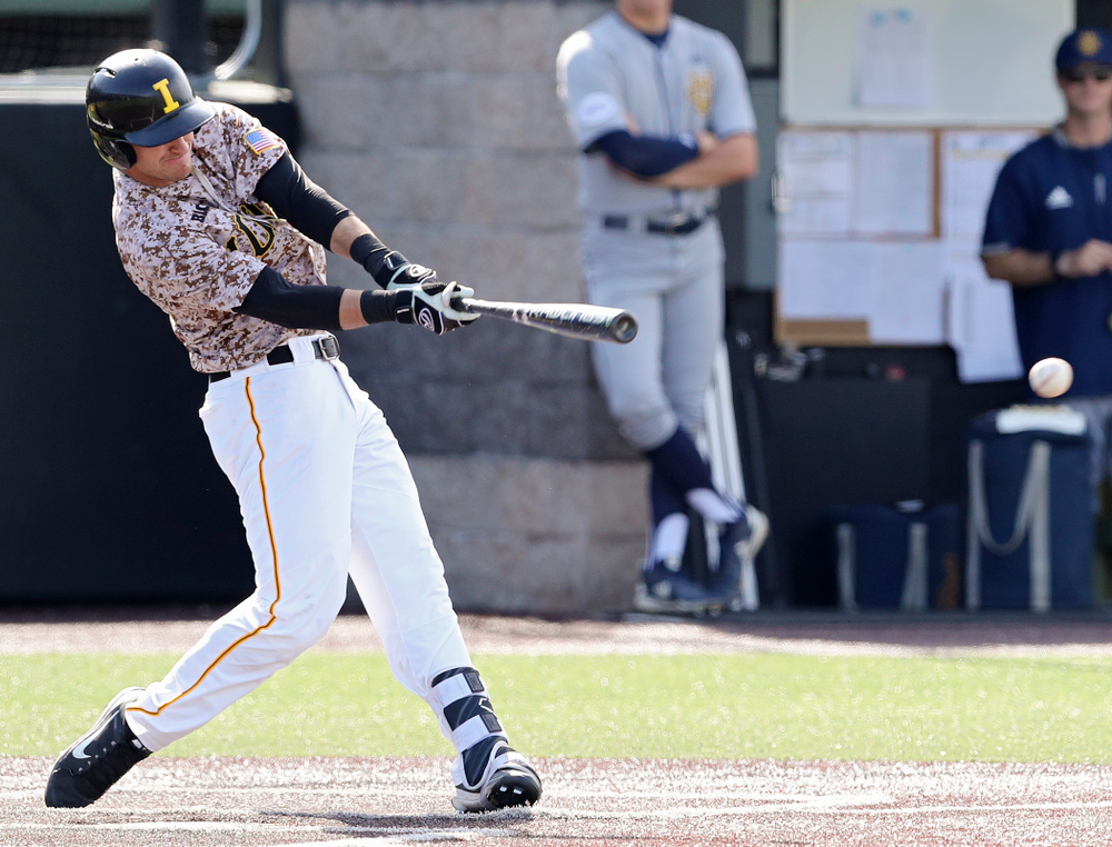 Iowa Hawkeyes shortstop Tanner Wetrich (16) hits an RBI single during the eighth inning of their game against UC Irvine at Duane Banks Field in Iowa City on Sunday, May. 5, 2019. (Stephen Mally/hawkeyesports.com)