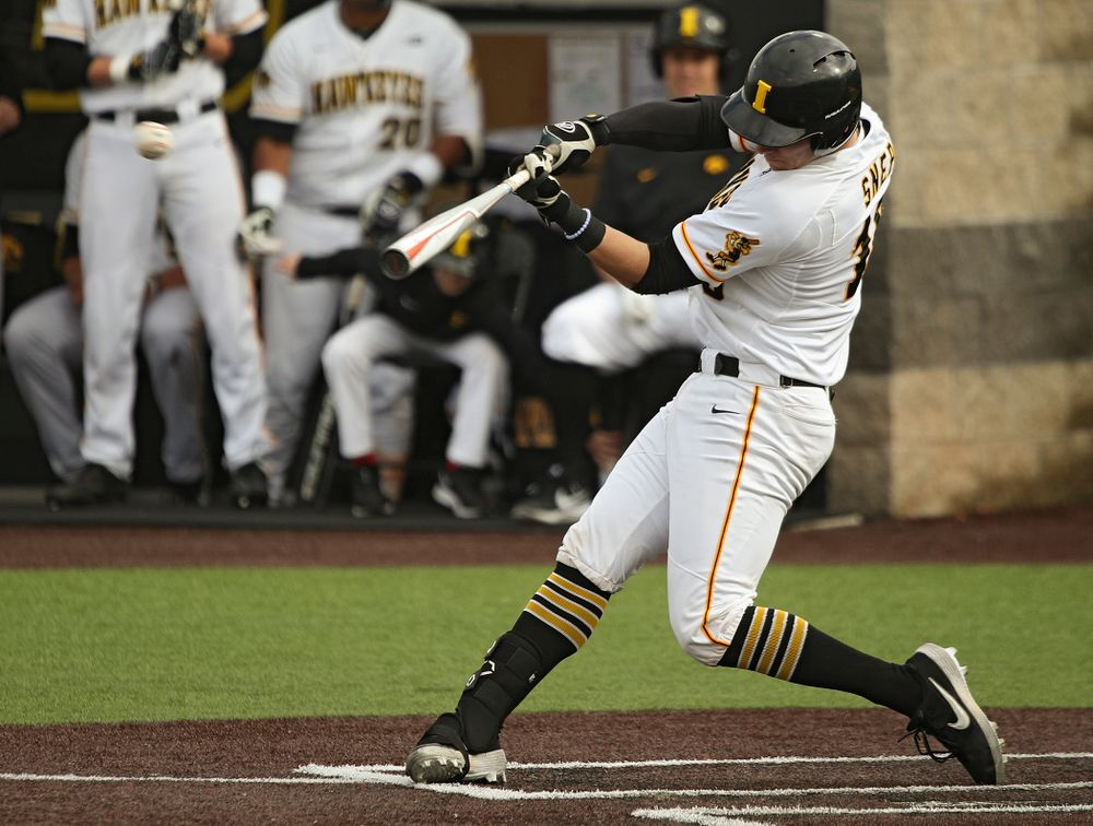 Iowa catcher Tyler Snep (16) hits a double during the seventh inning of their college baseball game at Duane Banks Field in Iowa City on Wednesday, March 11, 2020. (Stephen Mally/hawkeyesports.com)