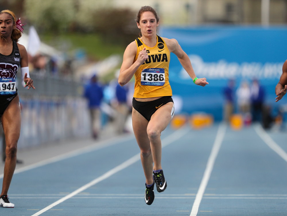 Iowa's Talia Buss runs the women's 200 meter dash event during the second day of the Drake Relays at Drake Stadium in Des Moines on Friday, Apr. 26, 2019. (Stephen Mally/hawkeyesports.com)