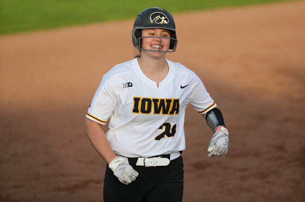 Iowa designated player Miranda Schulte (20) rounds the bases with a big smile after hitting a home run during the sixth inning of their game against Ohio State at Pearl Field in Iowa City on Friday, May. 3, 2019. (Stephen Mally/hawkeyesports.com)