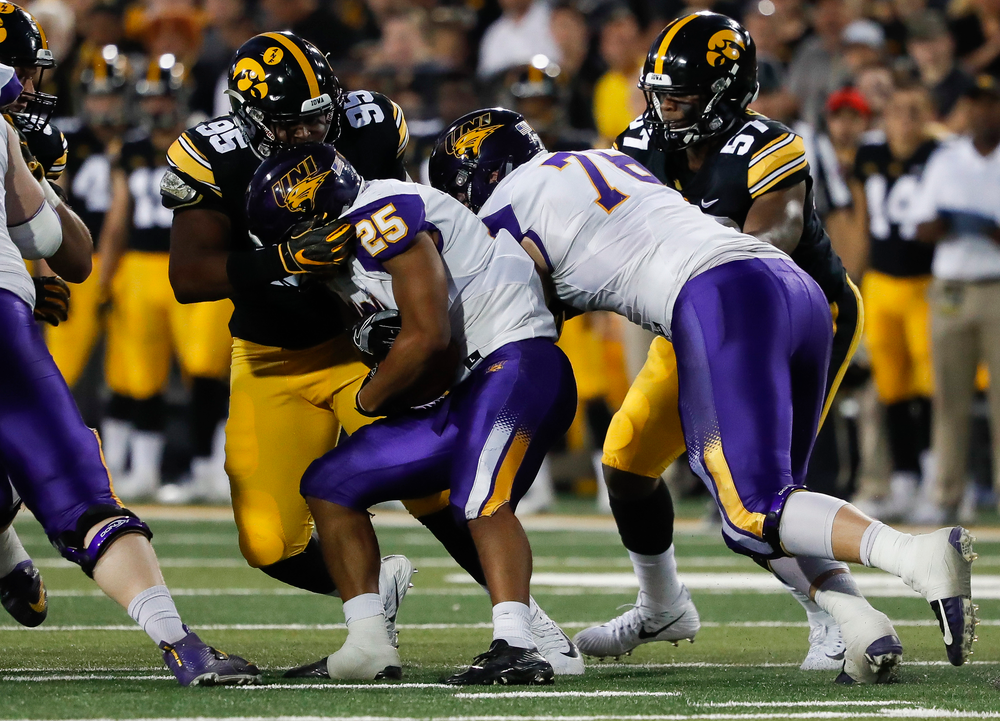 Iowa Hawkeyes defensive lineman Cedrick Lattimore (95) makes a tackle during a game against Northern Iowa at Kinnick Stadium on September 15, 2018. (Tork Mason/hawkeyesports.com)
