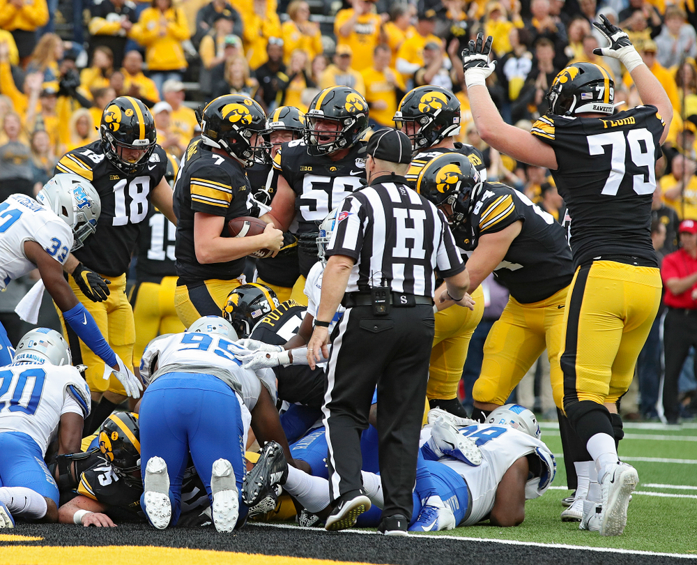 Iowa Hawkeyes quarterback Spencer Petras (7) celebrates after scoring a touchdown on a 1-yard run during fourth quarter of their game at Kinnick Stadium in Iowa City on Saturday, Sep 28, 2019. (Stephen Mally/hawkeyesports.com)