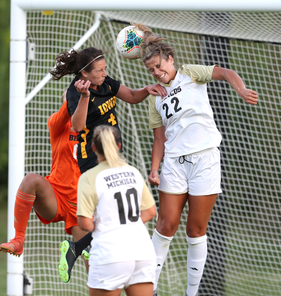 Iowa Hawkeyes forward Kaleigh Haus (4) heads the ball into the goal against Western Michigan Thursday, August 22, 2019 at the Iowa Soccer Complex. (Brian Ray/hawkeyesports.com)
