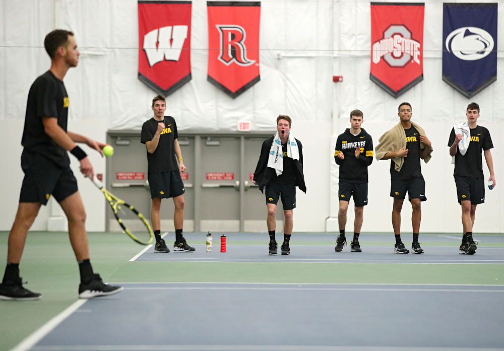 Iowa's Nikita Snezhko, Jason Kerst, Morgan Lohan, Oliver Okonkwo, and Matt Clegg celebrate after Kareem Allaf (left) won his match against Marquette at the Hawkeye Tennis and Recreation Complex in Iowa City on Saturday, January 25, 2020. (Stephen Mally/hawkeyesports.com)