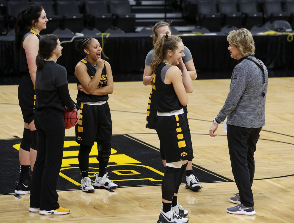 Iowa Hawkeyes forward Megan Gustafson (10), guard Tania Davis (11), guard Makenzie Meyer (3), guard Kathleen Doyle (22), and head coach Lisa Bluder share a laugh at a practice during the 2019 NCAA Women's Basketball Tournament at Carver Hawkeye Arena in Iowa City on Saturday, Mar. 23, 2019. (Stephen Mally for hawkeyesports.com)