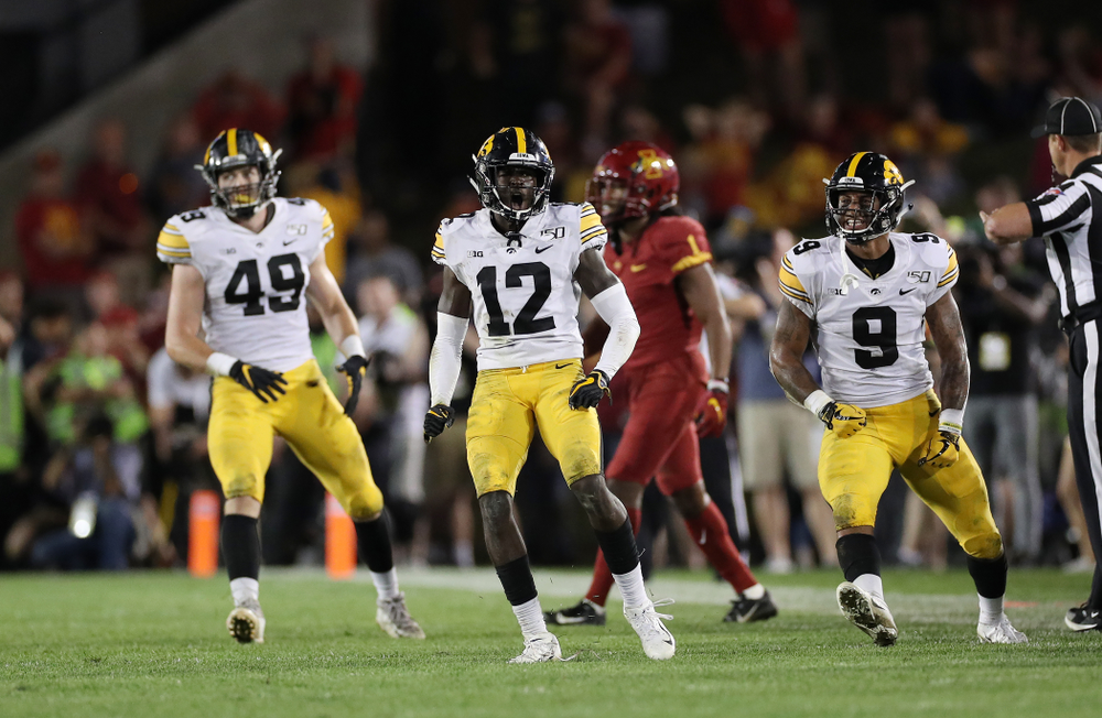 Iowa Hawkeyes defensive back D.J. Johnson (12) celebrates after breaking up a pass against the Iowa State Cyclones Saturday, September 14, 2019 in Ames, Iowa. (Brian Ray/hawkeyesports.com)