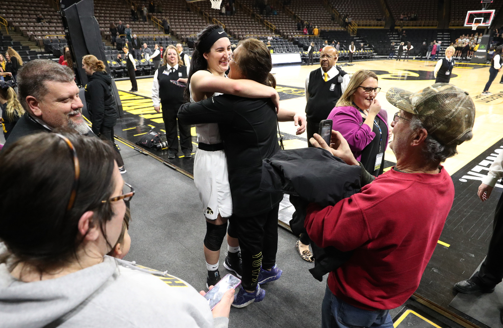 Iowa Hawkeyes forward Megan Gustafson (10) hugs her mother Eva following their game against the Illinois Fighting Illini Thursday, February 14, 2019 at Carver-Hawkeye Arena. (Brian Ray/hawkeyesports.com)