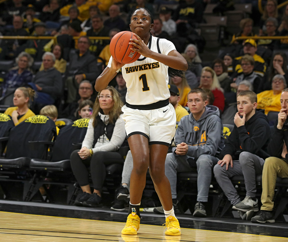 Iowa Hawkeyes guard Tomi Taiwo (1) makes a 3-pointer during the first quarter of their game at Carver-Hawkeye Arena in Iowa City on Tuesday, December 31, 2019. (Stephen Mally/hawkeyesports.com)