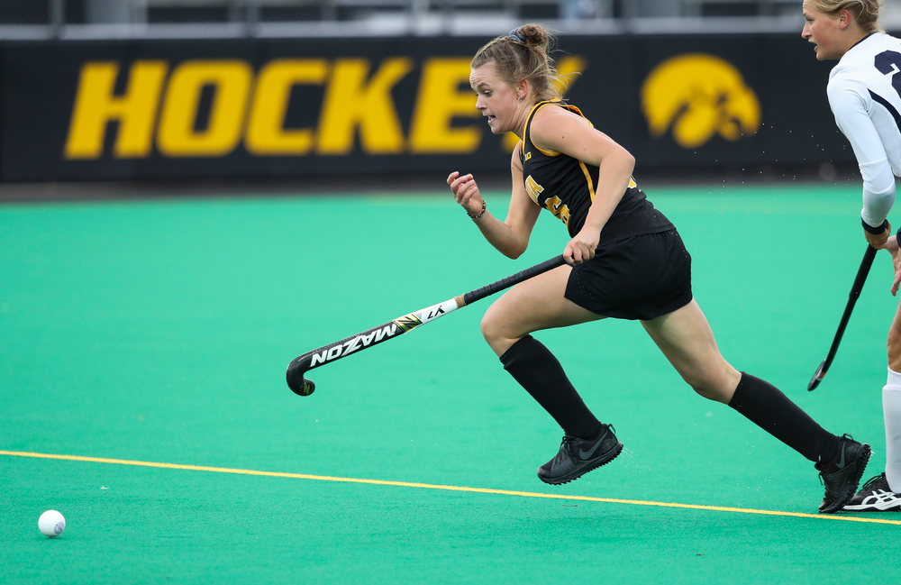 Iowa Hawkeyes forward Madeleine Murphy (26) chases down the ball during a game against No. 6 Penn State at Grant Field on October 12, 2018. (Tork Mason/hawkeyesports.com)