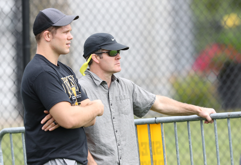 Iowa Wrestling head coach Tom Brands and former wrestler Nathan Burak watch during the Hawkeyes  6-1 win over Northern Iowa Sunday, August 25, 2019 at the Iowa Soccer Complex. (Brian Ray/hawkeyesports.com)