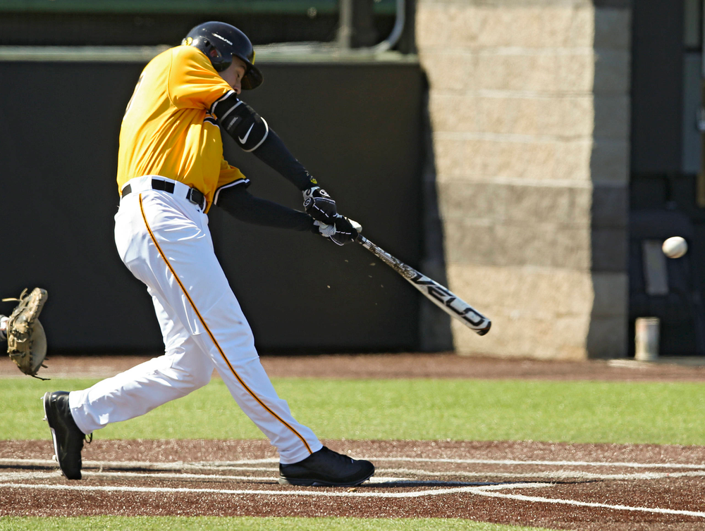 Iowa Hawkeyes right fielder Connor McCaffery (30) drives a pitch for a hit during the second inning against Illinois at Duane Banks Field in Iowa City on Sunday, Mar. 31, 2019. (Stephen Mally/hawkeyesports.com)