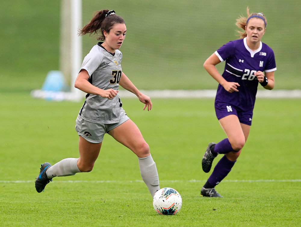 Iowa forward Devin Burns (30) moves with the ball during the first half of their match at the Iowa Soccer Complex in Iowa City on Sunday, Sep 29, 2019. (Stephen Mally/hawkeyesports.com)