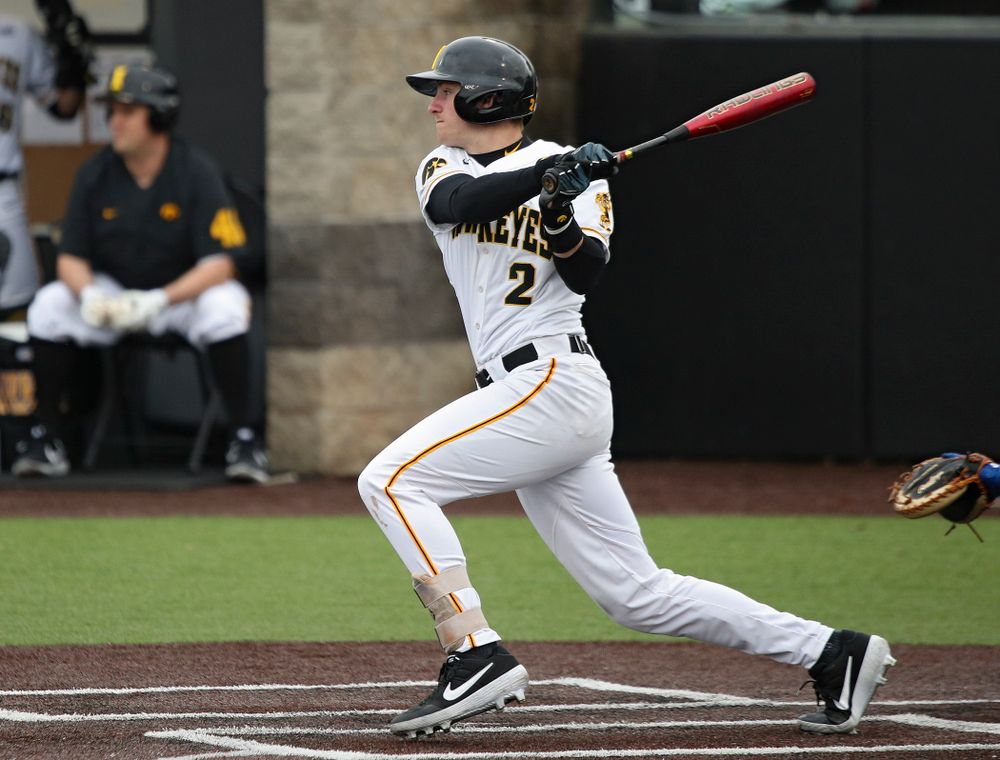 Iowa infielder Brendan Sher (2) hits an RBI single during the fourth inning of their college baseball game at Duane Banks Field in Iowa City on Wednesday, March 11, 2020. (Stephen Mally/hawkeyesports.com)