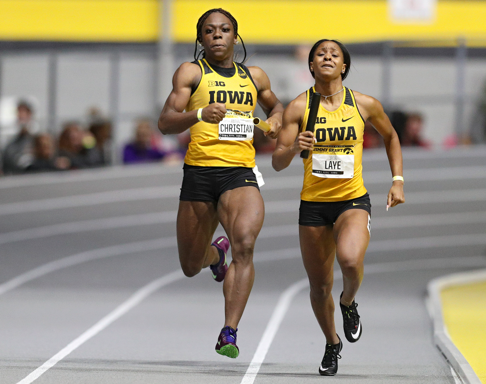 Iowa's Antonise Christian (from left) and Jada Laye run the women's 1600 meter relay event during the Jimmy Grant Invitational at the Recreation Building in Iowa City on Saturday, December 14, 2019. (Stephen Mally/hawkeyesports.com)