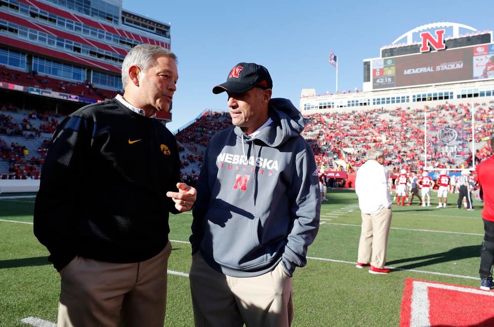 Iowa Hawkeyes head coach Kirk Ferentz and Nebraska Cornhuskers head coach Mike Riley