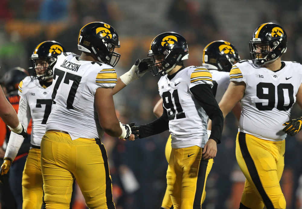 Iowa Hawkeyes place kicker Miguel Recinos (91) and offensive lineman Alaric Jackson (77) against the Illinois Fighting Illini Saturday, November 17, 2018 at Memorial Stadium in Champaign, Ill. (Brian Ray/hawkeyesports.com)