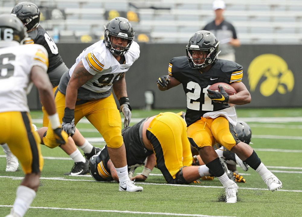Iowa Hawkeyes running back Ivory Kelly-Martin (21) makes a cut on a run during Fall Camp Practice No. 8 at Kids Day at Kinnick Stadium in Iowa City on Saturday, Aug 10, 2019. (Stephen Mally/hawkeyesports.com)