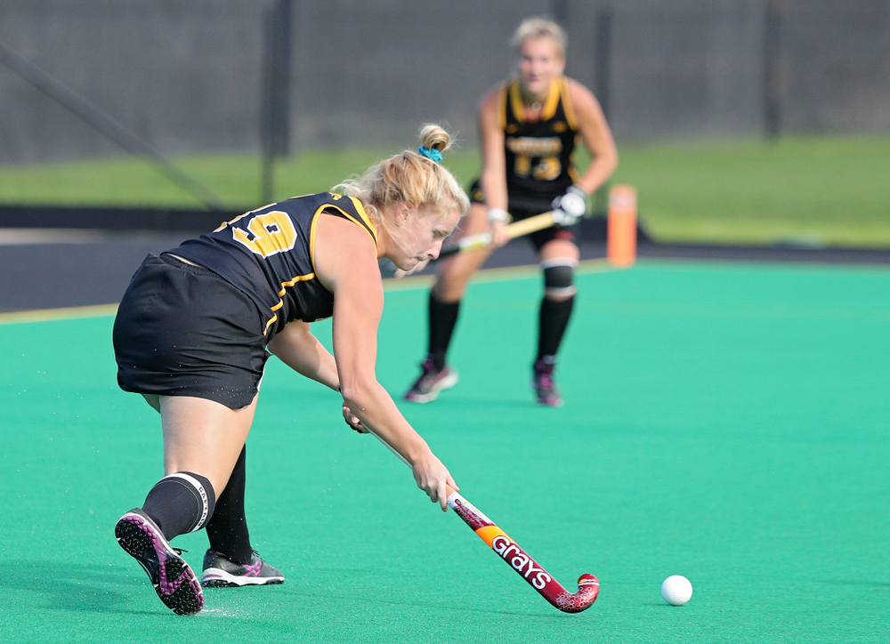 Iowa's Ryley Miller (19) passes to Leah Zellner (13) who scored a goal during the third quarter of their match at Grant Field in Iowa City on Friday, Oct 4, 2019. (Stephen Mally/hawkeyesports.com)