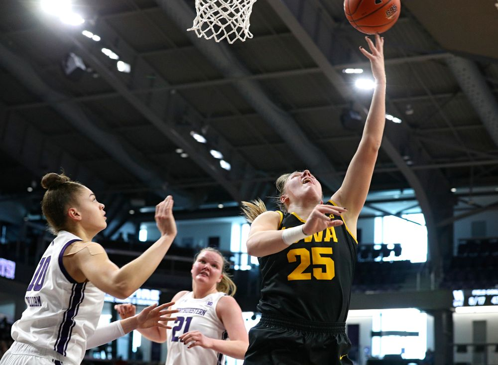 Iowa Hawkeyes forward Monika Czinano (25) scores a basket during the second quarter of their game at Welsh-Ryan Arena in Evanston, Ill. on Sunday, January 5, 2020. (Stephen Mally/hawkeyesports.com)