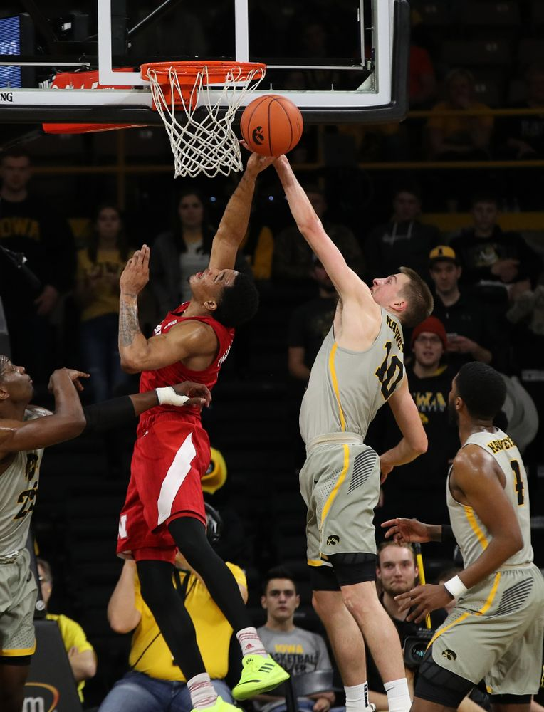 Iowa Hawkeyes guard Joe Wieskamp (10) blocks a shot against the Nebraska Cornhuskers Sunday, January 6, 2019 at Carver-Hawkeye Arena. (Brian Ray/hawkeyesports.com)