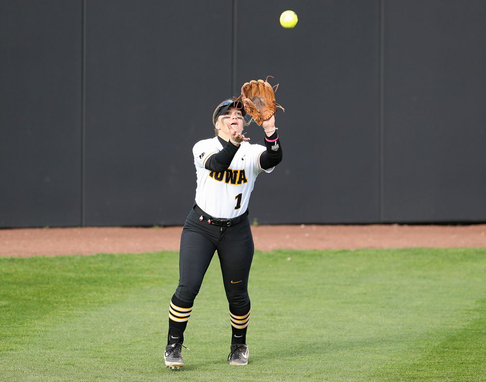 Iowa left fielder Cameron Cecil (1) pulls in a fly ball for an out during the fifth inning of their game against Illinois at Pearl Field in Iowa City on Friday, Apr. 12, 2019. (Stephen Mally/hawkeyesports.com)