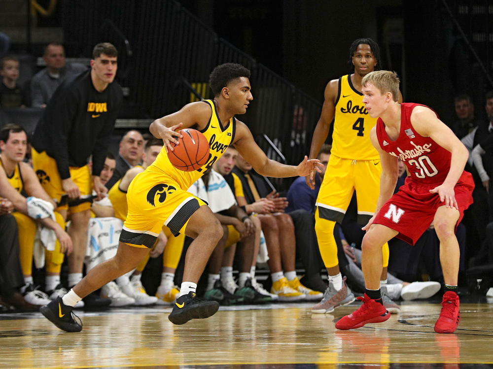 Iowa Hawkeyes guard Nicolas Hobbs (24) drives with the ball during the second half of their game at Carver-Hawkeye Arena in Iowa City on Saturday, February 8, 2020. (Stephen Mally/hawkeyesports.com)