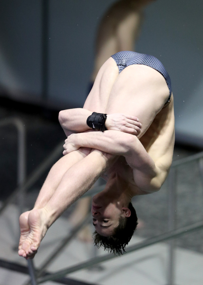IowaÕs Michael Huebner competes on the 1 meter springboard against Notre Dame and Illinois Saturday, January 11, 2020 at the Campus Recreation and Wellness Center.  (Brian Ray/hawkeyesports.com)