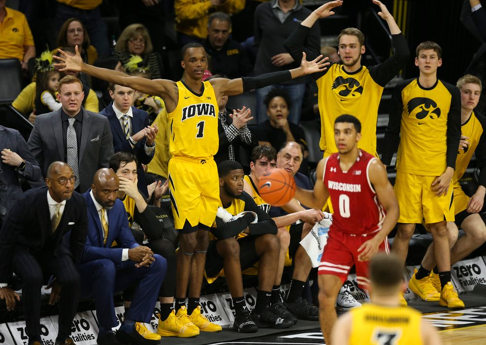 Iowa Hawkeyes guard Maishe Dailey (1) and Iowa Hawkeyes forward Riley Till (20) cheer from the bench against Wisconsin on November 30, 2018 at Carver-Hawkeye Arena. (Tork Mason/hawkeyesports.com)