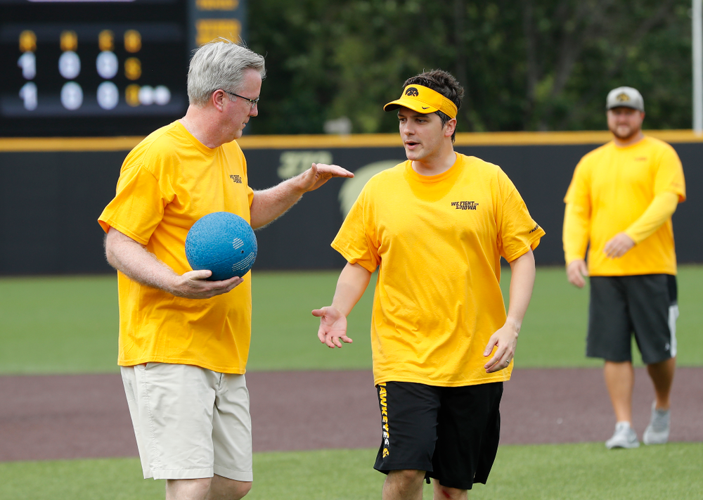 Head Men's Basketball Coach Fran McCaffery and Asst. Director Compliance Henry Archuleta during the Iowa Student Athlete Kickoff Kickball game  Sunday, August 19, 2018 at Duane Banks Field. (Brian Ray/hawkeyesports.com)