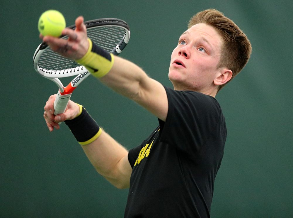 Iowa's Jason Kerst serves during his singles match at the Hawkeye Tennis and Recreation Complex in Iowa City on Friday, February 14, 2020. (Stephen Mally/hawkeyesports.com)