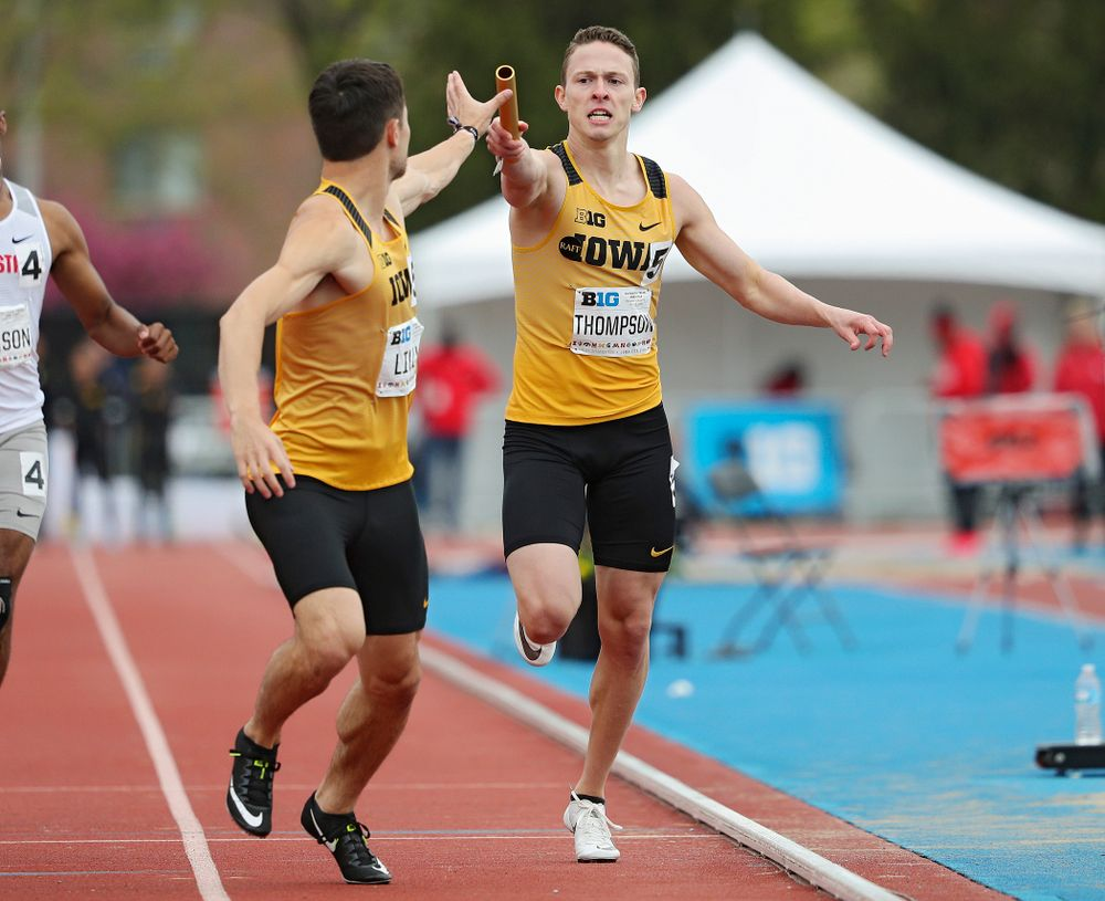 Iowa's Chris Thompson (right) hands the baton off to Carter Lilly during the 1600 meter relay event on the third day of the Big Ten Outdoor Track and Field Championships at Francis X. Cretzmeyer Track in Iowa City on Sunday, May. 12, 2019. (Stephen Mally/hawkeyesports.com)