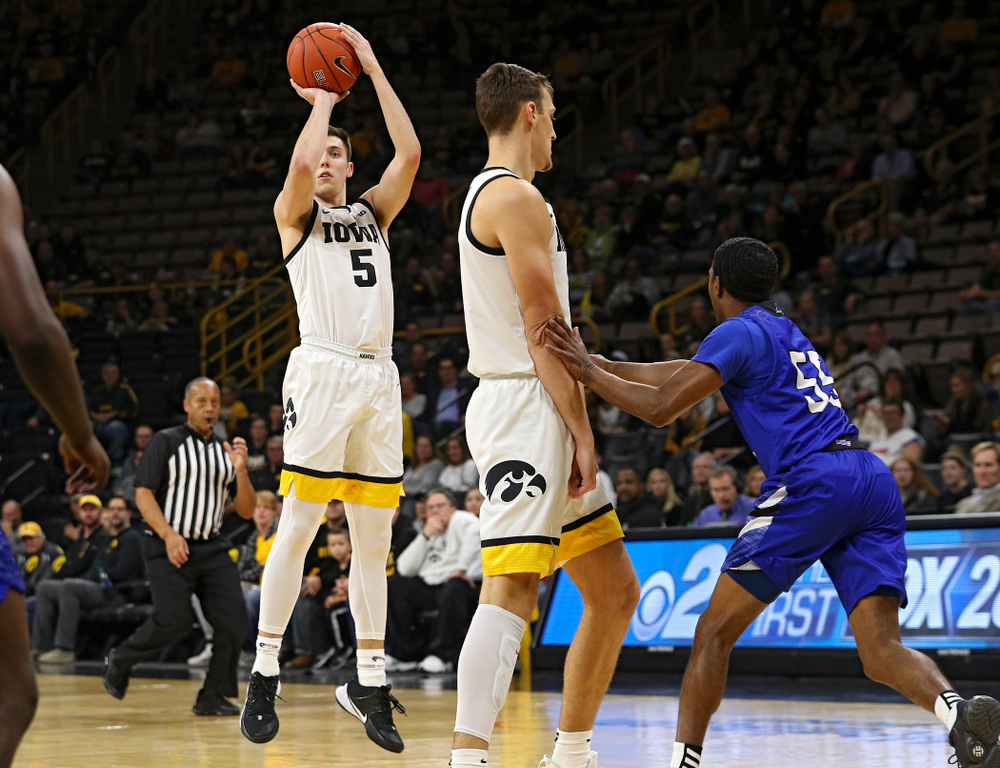 Iowa Hawkeyes guard CJ Fredrick (5) makes a 3-pointer behind forward Jack Nunge (2) during the first half of their exhibition game against Lindsey Wilson College at Carver-Hawkeye Arena in Iowa City on Monday, Nov 4, 2019. (Stephen Mally/hawkeyesports.com)