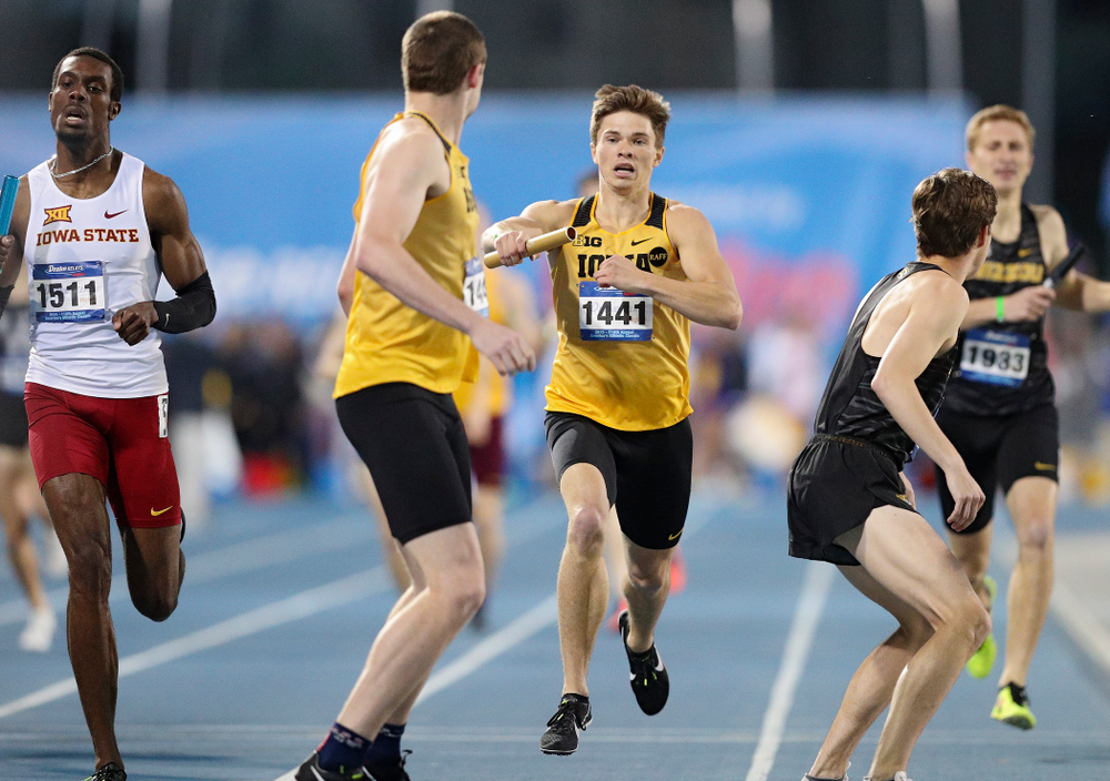 Iowa's Alec Still hands off the baton to Nolan Teubel runs the men's 3200 meter relay event during the second day of the Drake Relays at Drake Stadium in Des Moines on Friday, Apr. 26, 2019. (Stephen Mally/hawkeyesports.com)