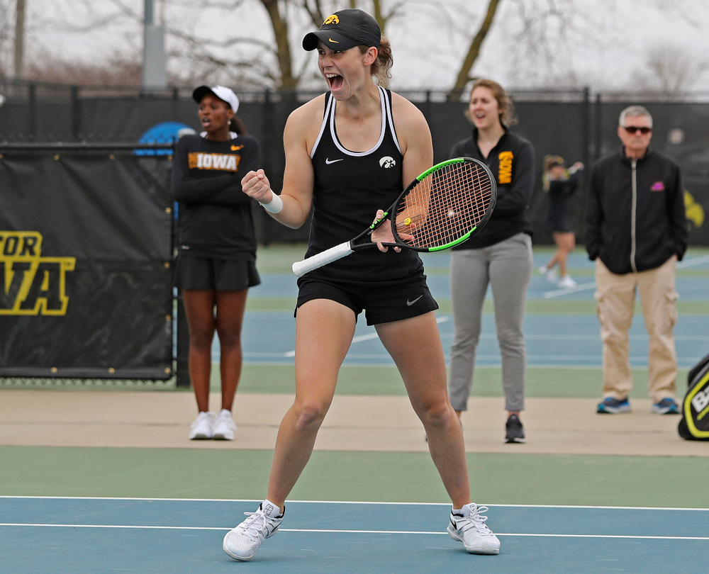 Iowa's Elise van Heuvelen Treadwell celebrates a point during their doubles match against Rutgers at the Hawkeye Tennis and Recreation Complex in Iowa City on Friday, Apr. 5, 2019. (Stephen Mally/hawkeyesports.com)